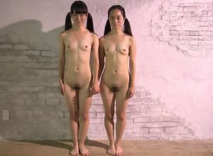 Lovely slim Chinese Sisters being..