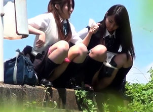 Asian virgins urinate arcs outdoors